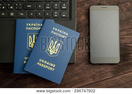 Preparation For Travel, Passports, Phone And Laptop Are On A Wooden Background. Horizontal Frame