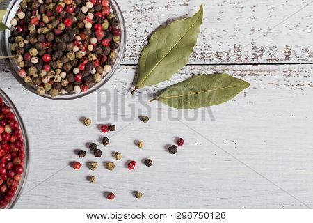 Assorted Pepper Spices. Pepper Mix. Black, Red And White Peppercorns And Dried Bay Laurel Leaves On