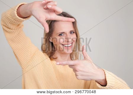 Portrait Of Young Blonde Woman With Cheerful Happy Expression On Her Face, With Good Mood, Making Sq