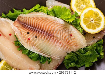 Whitefish Tilapia Fish Raw Fillet On Wooden Background. Selective Focus.