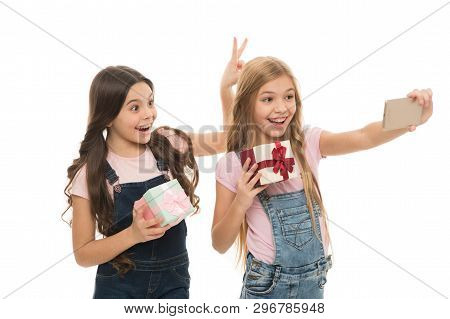 Posing As Models. Small Fashion Models Taking Selfie On Smartphone. Little Photo Models With Gifts C