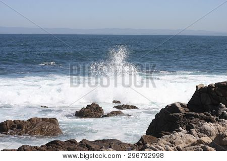 This Is An Image Of Spray From The Incoming Tide Along The Shoreline Of Pacific Grove, Californing T