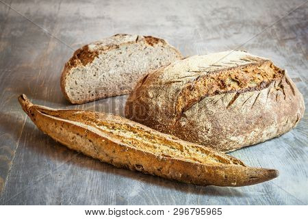 Three Loafs (or Miche) Of Baguette And French Sourdough, Called As Well As Pain De Campagne, On Disp