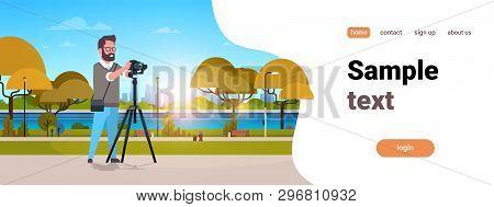 Man Professional Photographer Taking Photo Guy Using Dslr Camera On Tripod City Urban Park Landscape