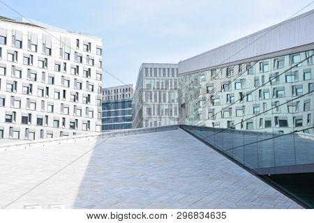1 March 2019, Oslo, Norway, Oslo Opera House. People Visit Oslo Opera House In Norway. The Building