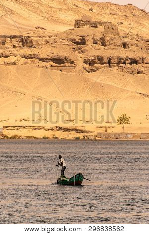Aswan, Egypt 21.05.2018 Fisherman In His Small Boat Fishing In The Center Of The River