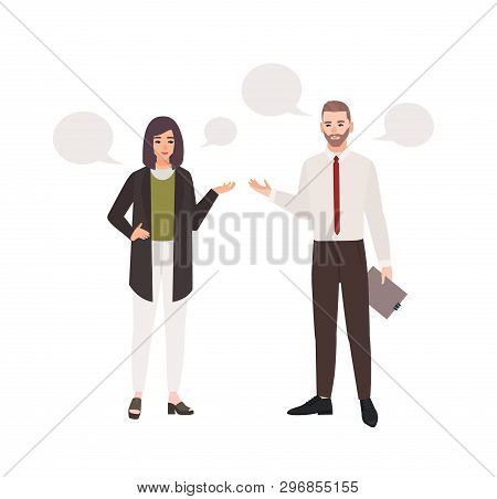 Pair Of Clerks Dressed In Business Clothes Standing And Talking To Each Other. Conversation Or Dialo