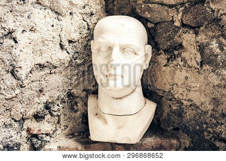 Bust of man, fragment of a statue in a museum Castello Normanno Museo Civico in castle Acicastello in Acitrezza, Catania, Sicily, Italy poster
