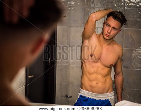 Shirtless Handsome Young Man In Bathroom By Sink
