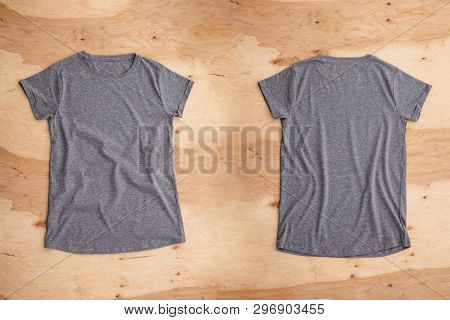 Front And Back Of Dark Grey Melange Empty T-shirt On Wooden Background. Horizontal View.