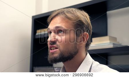 Enrages a man with a beard talking to someone in the office poster
