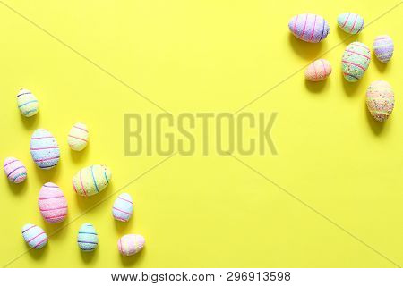 Easter Eggs On Yellow Background. The View From The Top. Copy Space