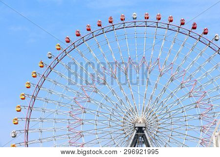 Ferris Wheel near to Tempozan Harbor village, Osaka, Japan. On blue sky background
