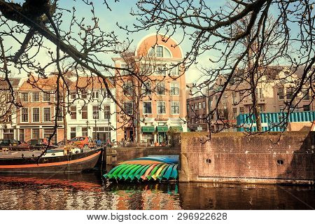 Hague, The Netherlands - Apr 6: Water Channels With Moored Boats And Canoe Riverboats For Rectreatio