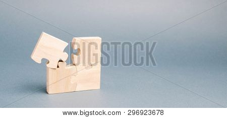 Wooden Puzzles On A Gray Background. One Puzzle Is Different. Individual Opinion. Stand Out From The