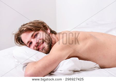 Man Handsome Guy Lay In Bed In Morning. Tips On How To Wake Up Feeling Fresh And Energetic. How To G