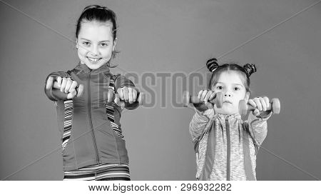 Strong And Healthy. Cute Sisters Have Physical Training Of Muscular Strength. Little Girls Building
