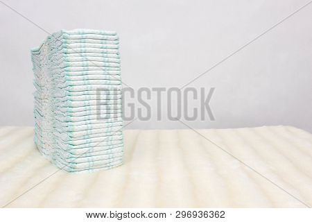 A Stack Of Baby Diapers On A White Background, Protection Against Leakage, Dryness And Comfort, Hypo