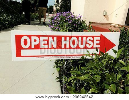 A Red Arrow Open House Sign For Real Estate.