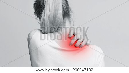 Woman With Symptoms Of Itchy Urticaria, Scratching Her Red Neck, Back View