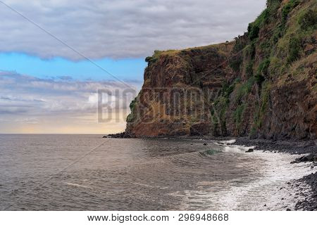 High Rugged Rocky Coastline Against Cloudy Sky At Sunset. This Photo Was Taken From Sandy Beach Prai