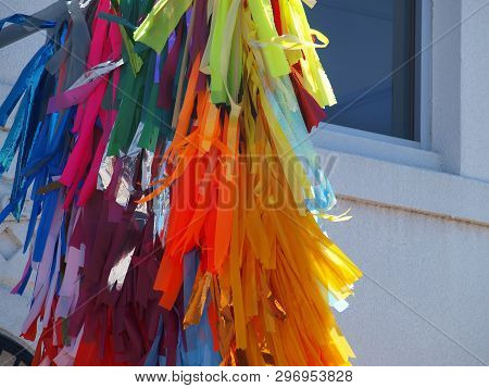 Colorful Prayer Cloths Hang From A Banner Outside A Temple In A Community Of Residents From Nepal.