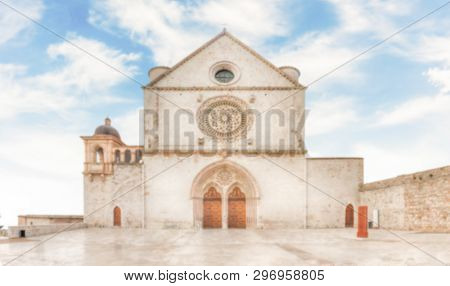 Defocused Background With Facade Of The Papal Basilica Of Saint Francis Of Assisi, Italy. Intentiona