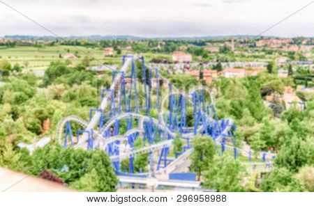 Defocused Background Of A Rollercoaster Inside An Amusement Park. Intentionally Blurred Post Product