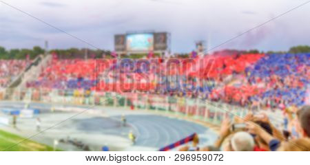 Defocused Background With Supporters In The Stadium For Football Match. Intentionally Blurred Post P