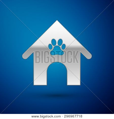 Silver Dog house and paw print pet icon isolated on blue background. Dog kennel. Vector Illustration poster