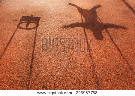 Shadow Of A Childs Swing On Rubber Cover