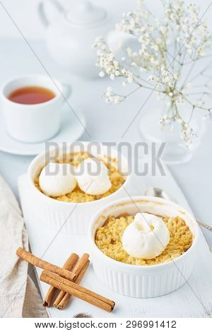 Apple Crumble With Streusel, Tea, Cinnamon On Light Gray Table. Vertical.