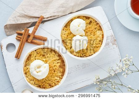 Apple Crumble With Ice Cream, Streusel, Flowers. Top View, Close Up