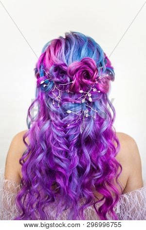 Elegant Hairstyle Of Curls On Long Colored Hair, Styling. Bright Color Coloring, Concept. Young Woma