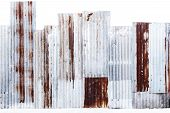 Rusty corrugated galvanized steel wall or iron metal sheet surface for texture and background. poster