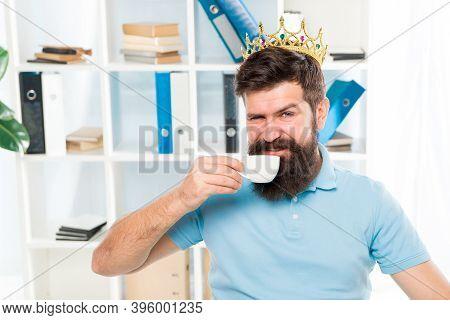 Reward For Fresh Ideas. Businessman In Gold Crown. Happy Man Drink Coffee. Boss Workplace. Bearded M