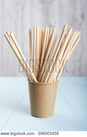 Biodegradable Cup With Drinking Straws On Light Grey Background.