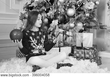 Found Gift Surprise Under Christmas Tree. Surprised Child Hold Gift Box And Ball. Christmas Surprise