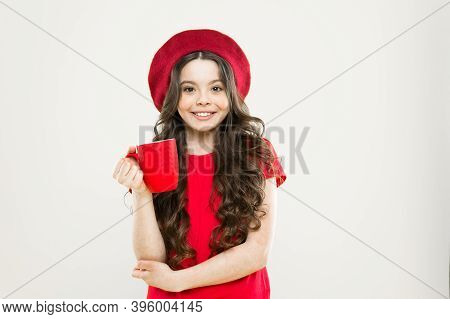 Little Girl In French Style Hat. Tea Time. Happy Girl With Long Curly Hair In Beret. Beauty Fashion.