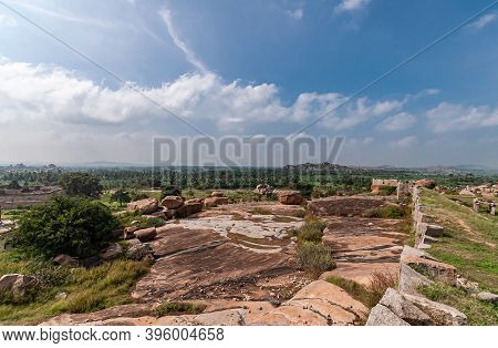 Hampi, Karnataka, India - November 4, 2013: Sunset Hill Aka Hemakatu. Ramparts Ruins And Boulders Un