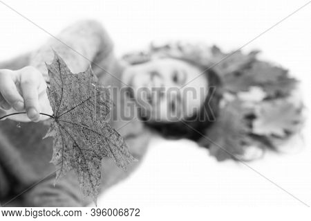 Take It. Child Giving Leaf Close Up. Girl Cute Kid Long Hair Lay On White Background With Fallen Lea