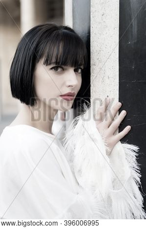 Woman With Red Lips, Makeup Face In Paris, France. Girl With Brunette Hair Hairstyle At Striped Colu