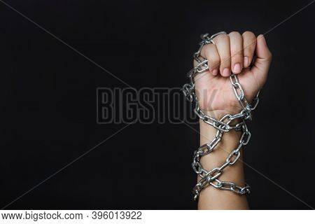 Woman Chained On Hand On Black Background, Human Trafficking And Abuse, International Human Rights D