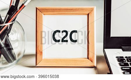 C2c Text Consumer To Consumer In A Wooden Frame On An Office Desk. Business Concept.