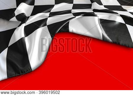 Checkered black and white flag on red background
