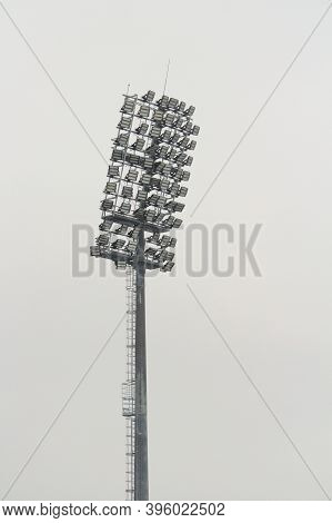 Stadium Floodlight With Metal Pole, Lighting Mast, Tower With Floodlights In The Sports Stadium Agai
