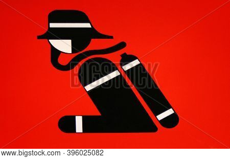 The Black Fireman Sign On Red Background