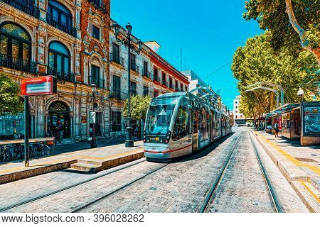 Tram On Streets In Downtown Of The City Seville, Spain.