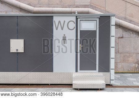 Modern Public Toilet Exterior Outdoor. Modern Toilet Metal Building, Outdoor, Day Time. Front View O