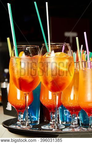 Multicolored Alcoholic And Non-alcoholic Cocktails With Ice And Straws